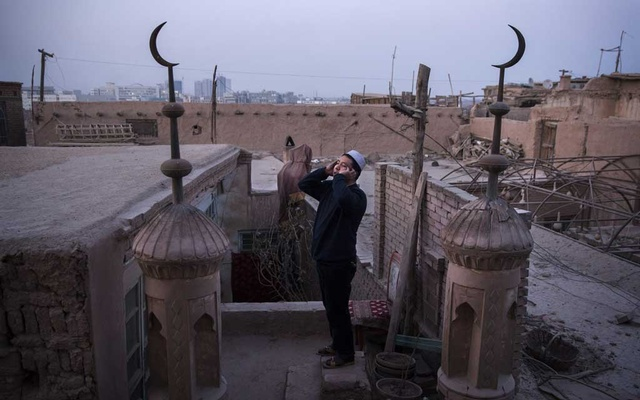 A muezzin sounds the call to prayer from the roof of a mosque in Kashgar, in China's far western province of Xinjiang, Dec. 14, 2015. Leaked documents provide an unprecedented inside look at China's crackdown in Xinjiang, in which as a million ethnic Uighurs, Kazakhs and others have been corralled into internment camps and prisons. (Adam Dean/The New York Times)