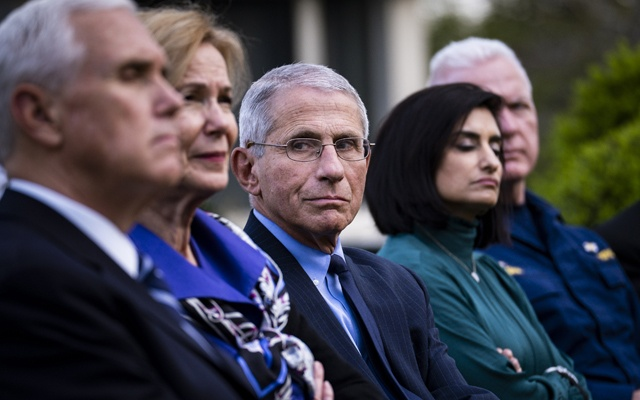 Dr. Anthony Fauci and members of the coronavirus task force attend President Donald Trump's briefing on the pandemic, at the White House in Washington, March 29, 2020. The top scientists battling the coronavirus estimated Tuesday that the deadly pathogen could kill 100,000 or more Americans in spite of social distancing measures. (Pete Marovich/The New York Times)
